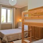 Chambre avec 1 grand lit + lits superposés